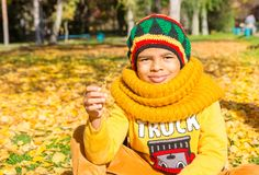 Autumn portrait of African American beautiful child. Happy little black boy with leaves in the park in fall. Royalty Free Stock Photos