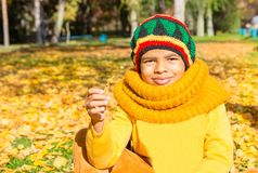 Autumn portrait of African American beautiful child. Happy littl Stock Photo
