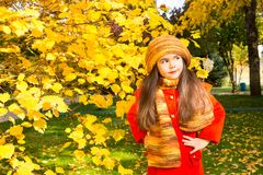 Autumn portrait of beautiful kazakh, asian child. Happy little girl with leaves in the park in fall. Autumn portrait of beautiful child. Happy little girl with Royalty Free Stock Photos