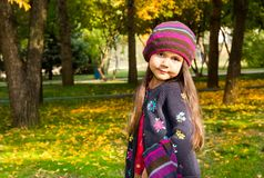 Autumn portrait of beautiful kazakh, asian child. Happy little girl with leaves in the park in fall. Autumn portrait of beautiful child. Happy little girl with Royalty Free Stock Photography