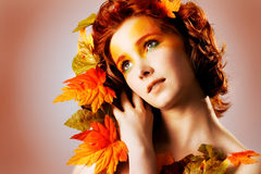 Autumn portrait of a beautiful female. Model stock photos