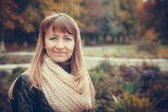 Autumn portrait of a beautiful girl. Portrait of a beautiful girl on a background of autumn trees Stock Photography