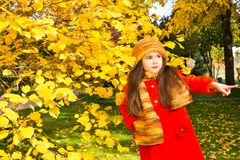 Autumn portrait of beautiful kazakh, asian child. Happy little girl with leaves in the park in fall. Autumn portrait of beautiful child. Happy little girl with Stock Image