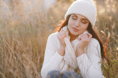Autumn portrait of a beautiful woman in the field royalty free stock photo