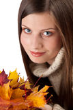 Autumn portrait of beautiful woman with leaf Royalty Free Stock Photo