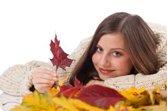 Autumn portrait of beautiful woman with leaf Stock Photos