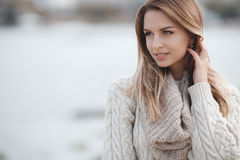 Autumn portrait of beautiful woman near the sea stock photography