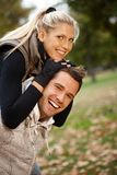 Autumn portrait of beautiful young smiling couple Stock Photos