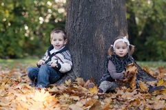 Autumn portrait of cute little caucasian couple Royalty Free Stock Photos