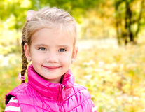 Autumn portrait of cute smiling little girl Royalty Free Stock Photo