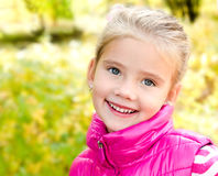 Autumn portrait of cute smiling little girl Royalty Free Stock Photography