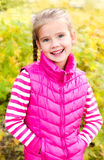 Autumn portrait of cute smiling little girl Stock Photo