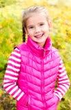 Autumn portrait of cute smiling little girl Stock Photo