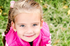Autumn portrait of cute smiling little girl Stock Images