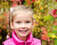 Autumn portrait of cute smiling little girl Royalty Free Stock Image