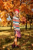 Autumn portrait in full growth of pretty young girl stock image