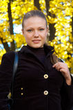 Autumn portrait of a girl. Outdoor portrait of a pretty girl on autumn background Stock Image