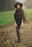 Autumn portrait of a girl posing in a field Royalty Free Stock Images