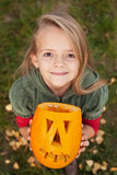 Autumn portrait with a Halloween pumpkin jack-o-lantern Stock Images