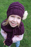 Autumn portrait of happy child girl in knitted purple hat and scarf Royalty Free Stock Photo