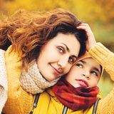 Autumn Portrait of Happy Family. Loving Mother and Son Stock Photo
