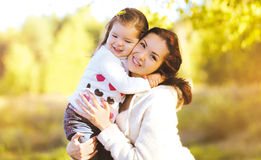 Autumn portrait happy smiling mother and child Stock Photos