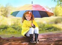 Autumn portrait  little child with colorful umbrella Stock Photo