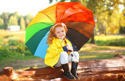 Autumn portrait little girl with colorful umbrella outdoors Royalty Free Stock Images