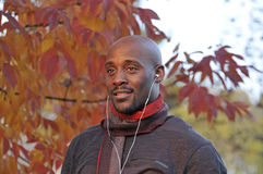 Autumn portrait of man with headphone Royalty Free Stock Images