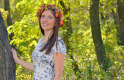 Autumn portrait o young woman. Autumn portrait of young woman in forest royalty free stock photos