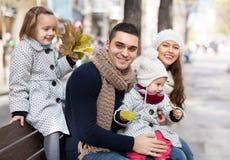 Autumn portrait of parents with children Stock Photos