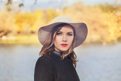 Autumn Portrait of Pretty Woman Fashion Model in Hat Royalty Free Stock Images