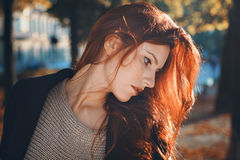 Autumn portrait of a red haired woman Stock Images