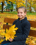 Autumn portrait of smiling little girl Stock Photos