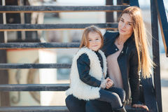 Autumn portrait of stylish mums and daughters Stock Photo