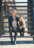 Autumn portrait of stylish mums and daughters Stock Images