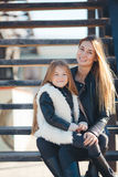 Autumn portrait of stylish mums and daughters Royalty Free Stock Image