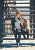 Autumn portrait of stylish mums and daughters Royalty Free Stock Photos
