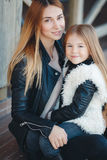 Autumn portrait of stylish mums and daughters Royalty Free Stock Photo