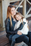 Autumn portrait of stylish mums and daughters Stock Photos