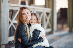 Autumn portrait of stylish mums and daughters Royalty Free Stock Images