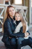 Autumn portrait of stylish mums and daughters Royalty Free Stock Photography