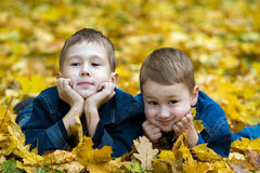 Autumn portrait of two brothers Royalty Free Stock Photos