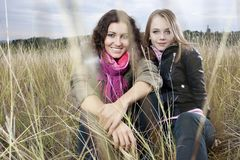 Autumn portrait of two young women Royalty Free Stock Image