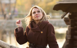 Autumn portrait of a woman on the bridge Royalty Free Stock Photography