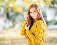 Autumn portrait of a young beautiful redhead woman in yellow sweater Stock Photos