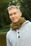Autumn portrait of young blonde man Royalty Free Stock Image