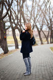 Young girl walking outdoor. Outdoor portrait of a young girl in the park Stock Image