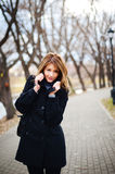 Girl walking outdoor. Outdoor portrait of a young girl in the park Stock Photography