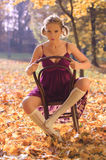 Autumn portrait of young pretty woman on a vintage Royalty Free Stock Photography